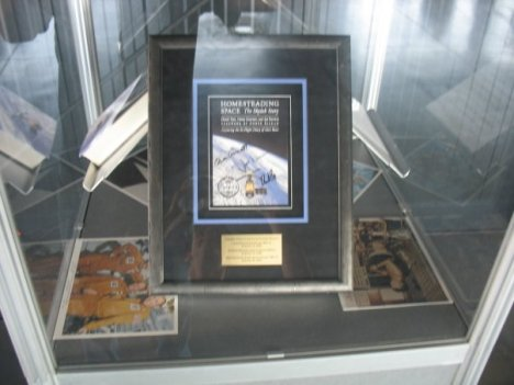 Buried somewhere in the archives of the U.S. Space & Rocket Center is an awesome display of a flown cover image of